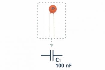 Przykładowy kondensator ceramiczny wraz zopisanym symbolem