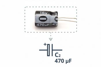 Przykładowy kondensator elektrolityczny wraz zopisanym symbolem
